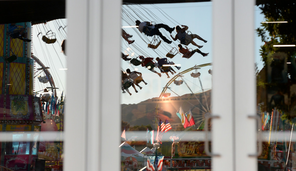 . Carnival rides are reflected in windows at the Alameda County Fair on Friday, June 27, 2014. (Doug Duran/Bay Area News Group)