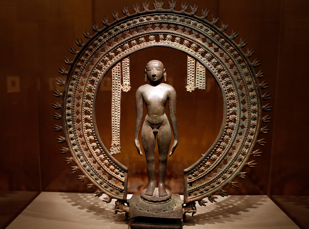 """. An 11th century bronze piece entitled \""""Standing Jina\"""" is on display at the new exhibit, \""""Yoga: The Art of Transformation\"""" at the Asian Art Museum Wednesday morning, Feb. 19, 2014, in San Francisco, Calif. (Karl Mondon/Bay Area News Group)"""