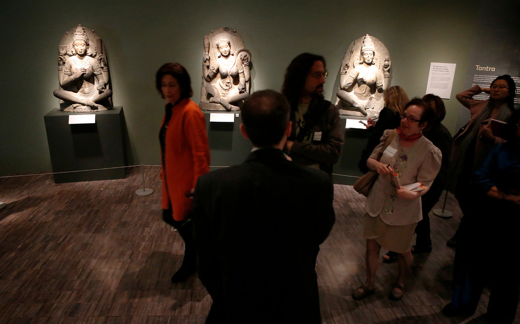 """. Debra Diamond, a Smithsonian associate curator of south and southeast Asian art, leads a tour through the new exhibit \""""Yoga: The Art of Transformation\"""" at the Asian Art Museum Wednesday morning, Feb. 19, 2014, in San Francisco, Calif. The exhibit was first displayed at the Smithsonian. (Karl Mondon/Bay Area News Group)"""
