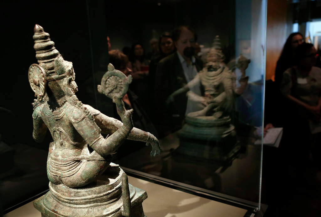 """. A bronze Narasahima, a man-lion incarnation of the Hindu deity Vishna,  is part of the new exhibit  \""""Yoga: The Art of Transformation\"""" at the Asian Art Museum Wednesday morning, Feb. 19, 2014, in San Francisco, Calif. (Karl Mondon/Bay Area News Group)"""