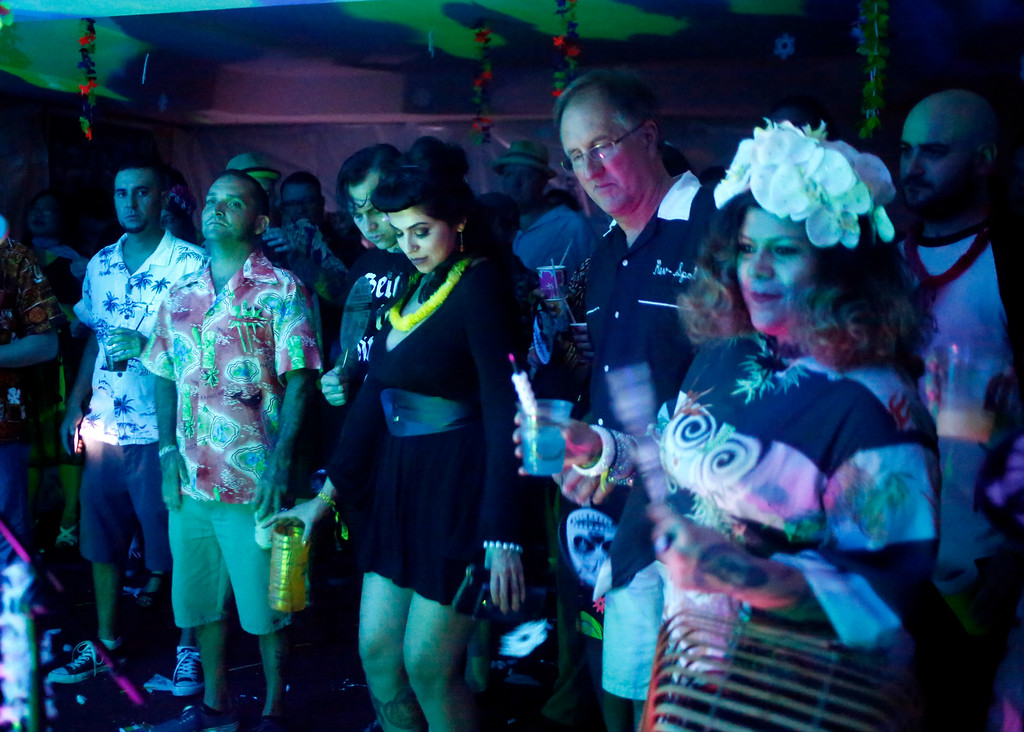 """. A crowd gathers at a suite party during the16th Annual Tiki Oasis \""""Party on Monster Island,\"""" at the Crown Plaza, formerly the Hanalei Hotel in San Diego, Calif., on Friday, August 19, 2016. (Josie Lepe/Bay Area News Group)"""