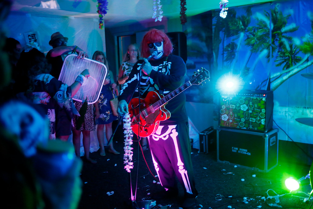 """. The Fink Bombs perform in one of the suite parties at the 16th Annual Tiki Oasis \""""Party on Monster Island,\"""" at the Crown Plaza, formerly the Hanalei Hotel in San Diego, Calif., on Friday, August 19, 2016. (Josie Lepe/Bay Area News Group)"""