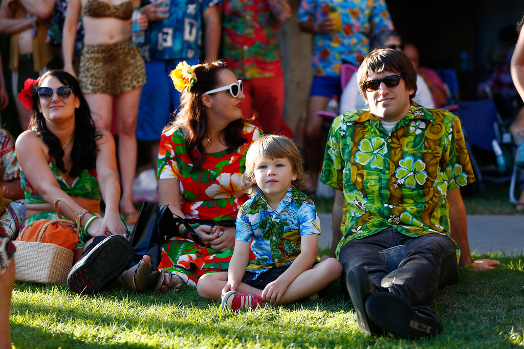 """. Elias Hugunin, 5, is photographed with dad as they sit on the lawn during a concert at the 16th Annual Tiki Oasis \""""Party on Monster Island,\"""" at the Crown Plaza, formerly the Hanalei Hotel in San Diego, Calif., on Friday, August 19, 2016. (Josie Lepe/Bay Area News Group)"""