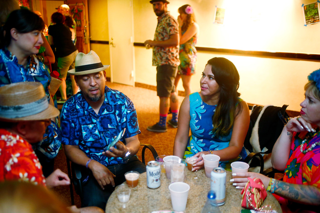 """. Tonya Greenwood, Ignacio \""""Noch\"""" Gonzalez, Angel Vargas and Vanessa Kunkel, of San Jose, converse during a suite party at the 16th Annual Tiki Oasis \""""Party on Monster Island,\"""" at the Crown Plaza, formerly the Hanalei Hotel in San Diego, Calif., on Friday, August 19, 2016. (Josie Lepe/Bay Area News Group)"""