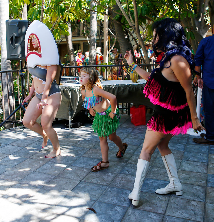 """. Kaye Loraine Sledge, 7, of Concord, dances with the Go Go dancers at the 16th Annual Tiki Oasis \""""Party on Monster Island,\"""" at the Crown Plaza, formerly the Hanalei Hotel in San Diego, Calif., on Friday, August 19, 2016. (Josie Lepe/Bay Area News Group)"""