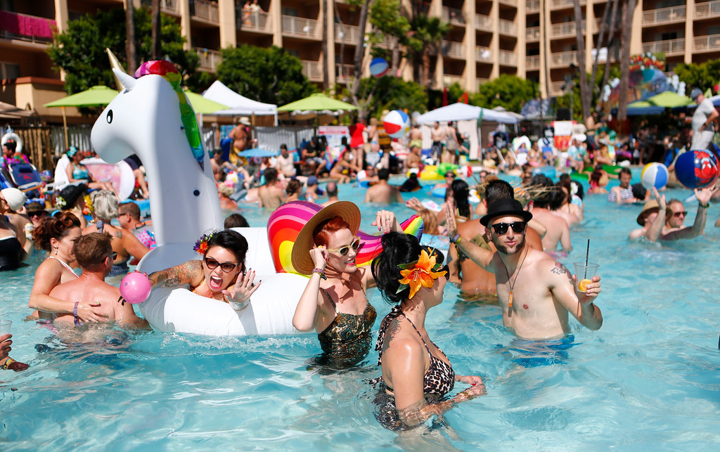""". Tiki crowd dance as they cool off in the pool at the 16th Annual Tiki Oasis \"""" Part On Monster Island\"""", at the Crown Plaza, formerly the Hanalei Hotel in San Diego , Calif., on Saturday, August 20, 2016. (Josie Lepe/Bay Area News Group)"""