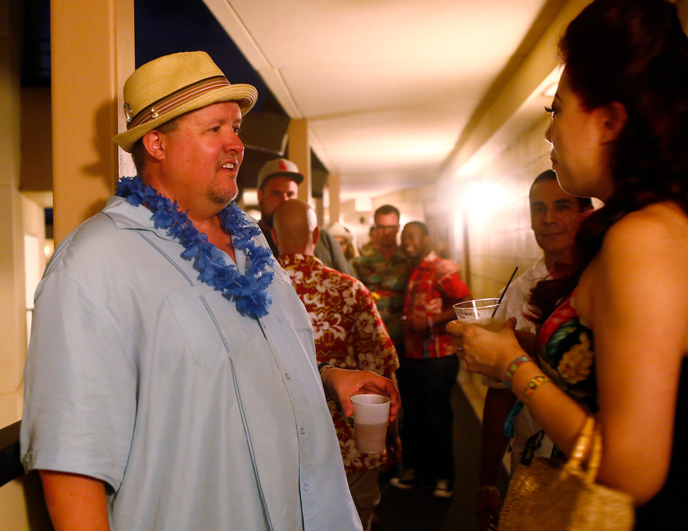 """. Web engineer Mark Holt, of Los Gatos, talks with a guest outside a suite party he is hosting at 16th Annual Tiki Oasis \""""Party on Monster Island,\"""" at the Crown Plaza, formerly the Hanalei Hotel in San Diego, Calif., on Friday, August 19, 2016. (Josie Lepe/Bay Area News Group)"""