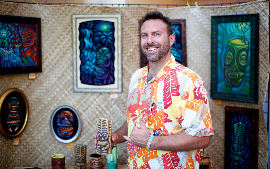 """. Artist Woody Miller, of Oakland, is photographed in his both at the 16th Annual Tiki Oasis \""""Party on Monster Island,\"""" at the Crown Plaza, formerly the Hanalei Hotel in San Diego, Calif., on Friday, August 19, 2016. (Josie Lepe/Bay Area News Group)"""