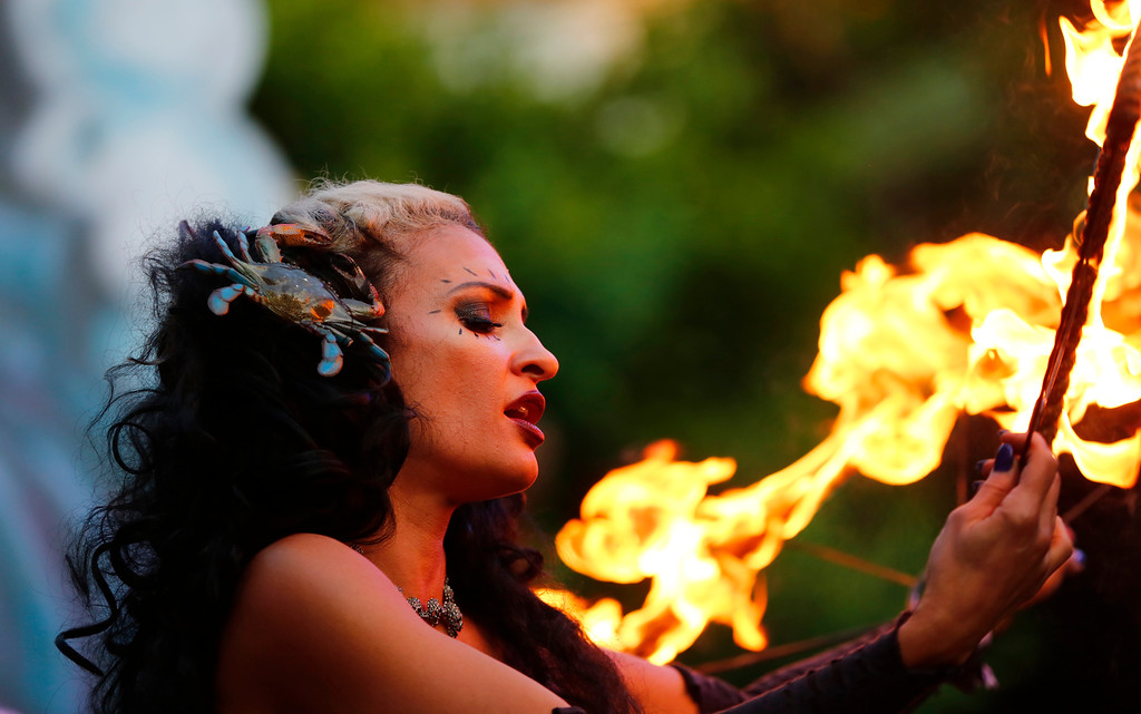 """. Marina the \""""Fire Eating Mermaid,\"""" of Fort Lauderdale, performs at the 16th Annual Tiki Oasis \""""Party on Monster Island,\"""" at the Crown Plaza, formerly the Hanalei Hotel in San Diego, Calif., on Friday, August 19, 2016. (Josie Lepe/Bay Area News Group)"""