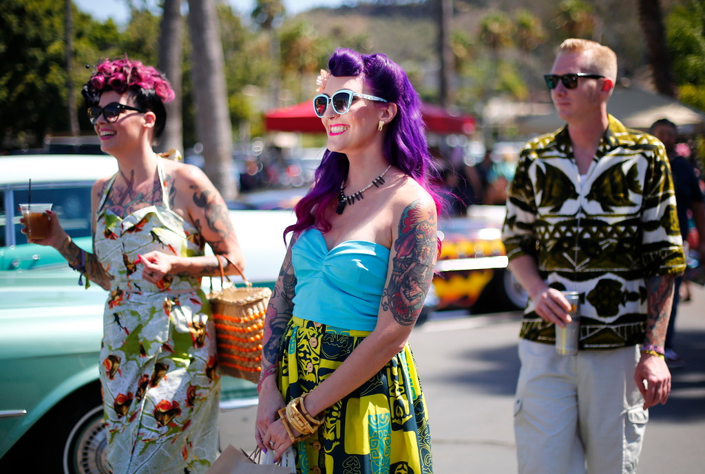 """. (left- right) Liz Damron, Nicole Reynolds of San Jose, and Matt Moran are photographed walking around the car show at the 16th Annual Tiki Oasis \""""Party on Monster Island,\"""" at the Crown Plaza, formerly the Hanalei Hotel in San Diego, Calif., on Friday, August 19, 2016. (Josie Lepe/Bay Area News Group)"""