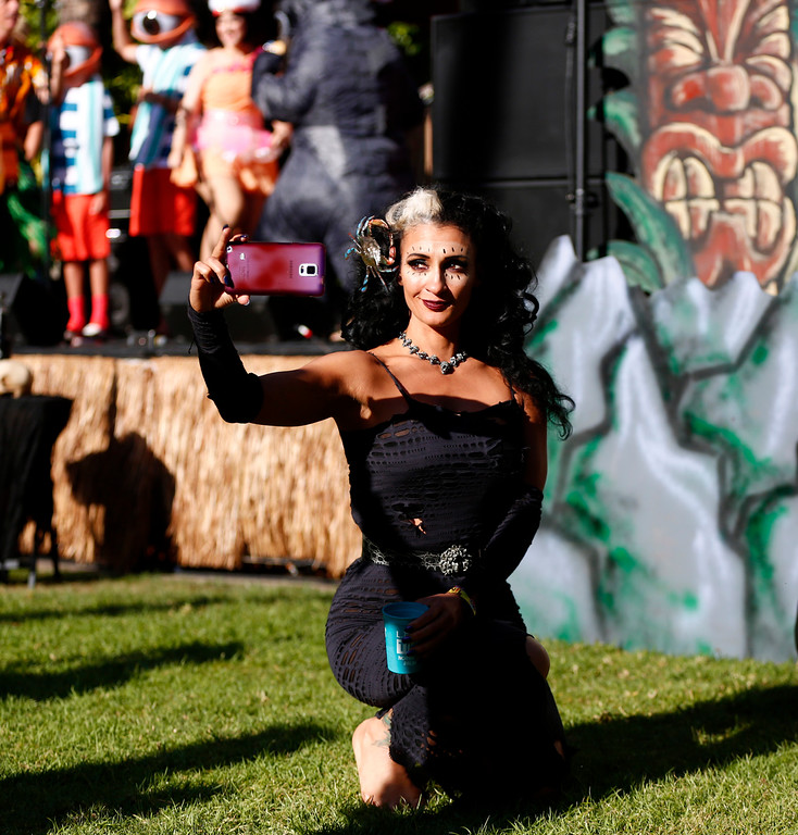 """. Marina the \""""Fire Eating Mermaid,\"""" of Fort Lauderdale, is photographed taking a selfie at the 16th Annual Tiki Oasis \""""Party on Monster Island,\"""" at the Crown Plaza, formerly the Hanalei Hotel in San Diego, Calif., on Friday, August 19, 2016. (Josie Lepe/Bay Area News Group)"""