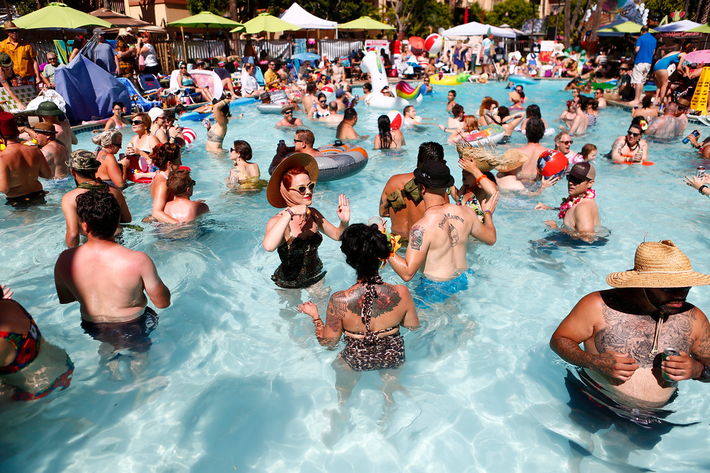 """. Tiki crowd cools off in the pool at the 16th Annual Tiki Oasis \"""" Part On Monster Island\"""", at the Crown Plaza, formerly the Hanalei Hotel in San Diego , Calif., on Saturday, August 20, 2016. (Josie Lepe/Bay Area News Group)"""