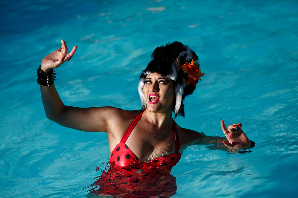 """. Annisse Damefatale, of Los Angeles, is photographed in the pool during the 16th Annual Tiki Oasis \""""Party on Monster Island,\"""" at the Crown Plaza, formerly the Hanalei Hotel in San Diego, Calif., on Friday, August 19, 2016. (Josie Lepe/Bay Area News Group)"""