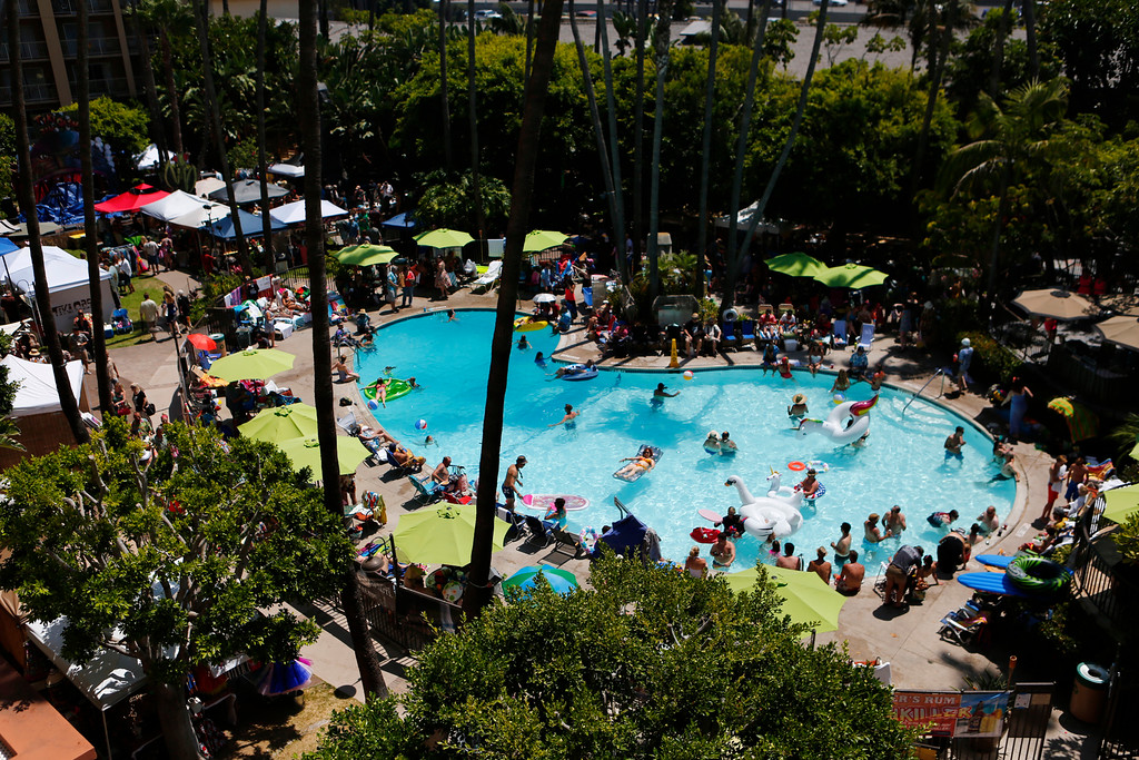 """. View of the pool at the 16th Annual Tiki Oasis \""""Party on Monster Island,\"""" at the Crown Plaza, formerly the Hanalei Hotel in San Diego, Calif., on Friday, August 19, 2016. (Josie Lepe/Bay Area News Group)"""