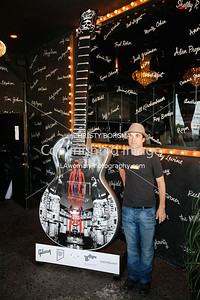 "Nic Adams at the Comedy Store with the guitar he created: ""Prince Of Darkness"" celebrating Ozzy Osbourne."