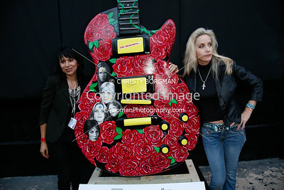 Cherie Currie with Sonia Lopez Chaves who designed this Runaways inspired guitar.