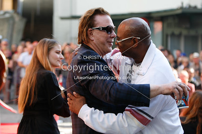 Mickey Rourke and Larry Musgrove at Grauman's Chinese Theatre for his hand and footprint ceremony
