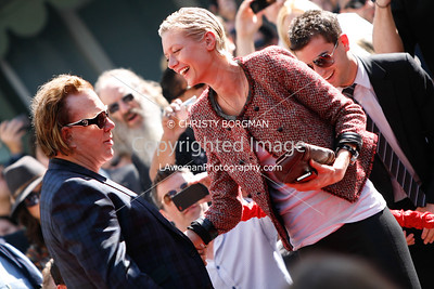 Mickey Rourke and Anastassija Makarenko at Grauman's Chinese Theatre for his hand and footprint ceremony