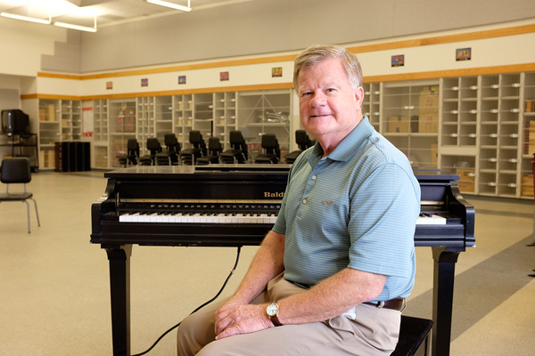 JOED VIERA/STAFF PHOTOGRAPHER-Lockport, NY-Starpoint superintendant C. Douglas Whelan sits at a piano in the music wing at Starpoint which was just named in his honor.