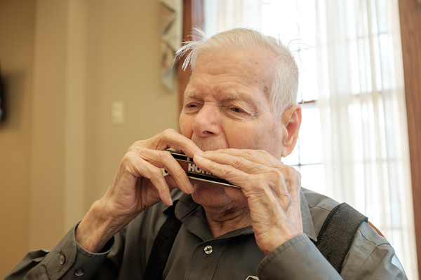 JOED VIERA/STAFF PHOTOGRAPHER-Lockport, NY-Roy Youngstrom, 94, plays his Hohner Chromonica at Lockport Presbyterian Home. Youngstrom recently picked the instrument back up after a 69 year hiatus.