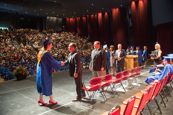 JOED VIERA/STAFF PHOTOGRAPHER-Lewiston, NY-Lockport High School student Robin Rush receives her diploma during her graduation ceremony at Artpark.