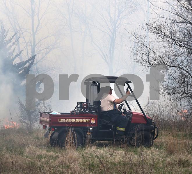 dc.0502.brushfireCOVER