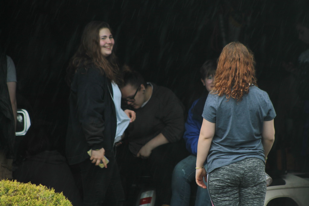 . Students from Chardon High School take  a break from the  rain during their community service field trip at Santa\'s Hide-A-Way Hollow in Middlefield on May 3. Kristi Garabrandt - The News-Herald