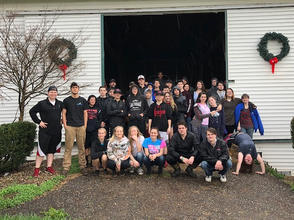 . Students from Chardon High School spend  the day on a  community service field trip at Santa\'s Hide-A-Way Hollow in Middlefield on May 3. Submitted