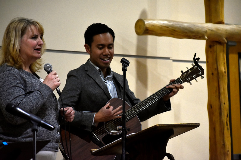 Teresa Johansen (left) and Nestor Soriano (right), both from Campion, sing a song of praise to start off the night during Loveland's National Day of Prayer event on Thursday, May 3, 2018, at House of Neighborly Service in Loveland. Photo by Thieng Mai/Loveland Reporter-Herald.
