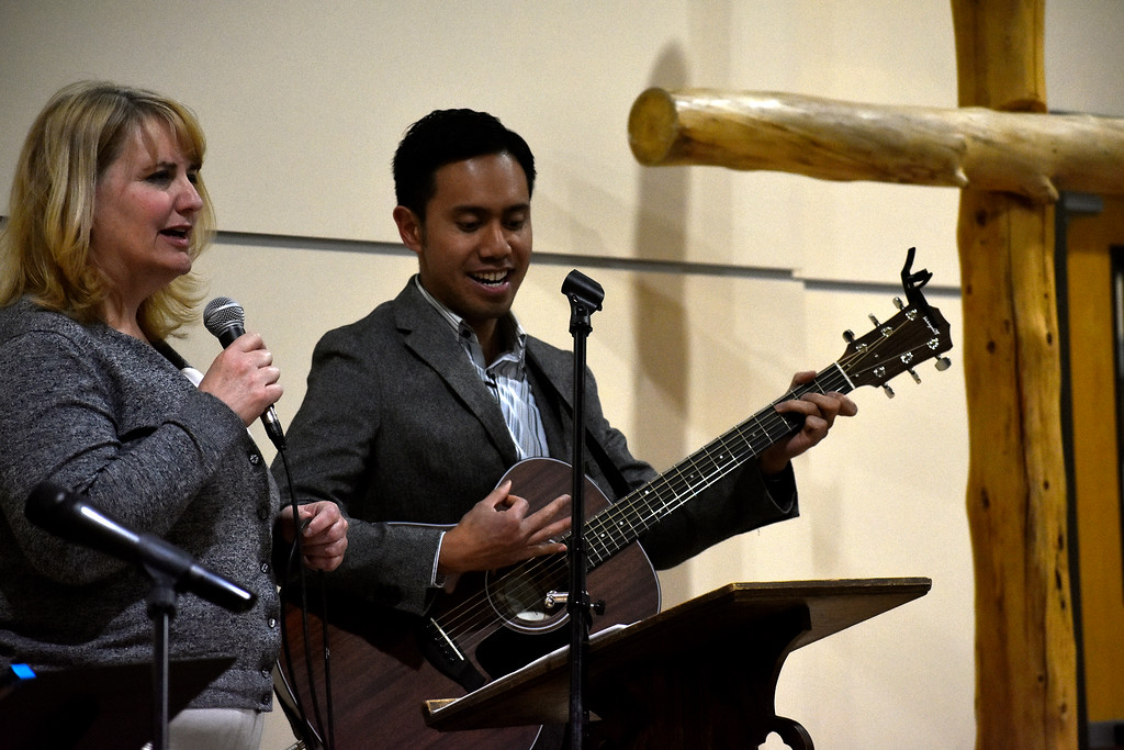 . Teresa Johansen (left) and Nestor Soriano (right), both from Campion, sing a song of praise to start off the night during Loveland\'s National Day of Prayer event on Thursday, May 3, 2018, at House of Neighborly Service in Loveland. Photo by Thieng Mai/Loveland Reporter-Herald.