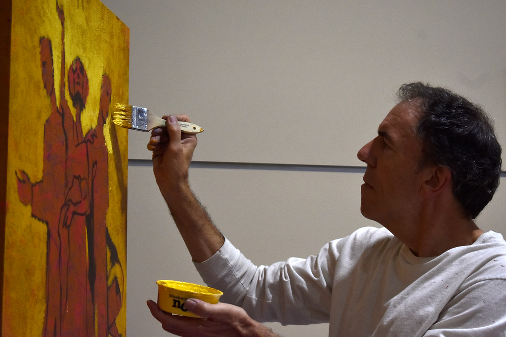 . Artist Scott Freeman, from Loveland, works on a painting while listening to words of prayer during Loveland\'s National Day of Prayer event on Thursday, May 3, 2018, at House of Neighborly Service in Loveland. Photo by Thieng Mai/Loveland Reporter-Herald.