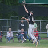 Sycamore's Jacob Reidl makes a leaping catch at first base.