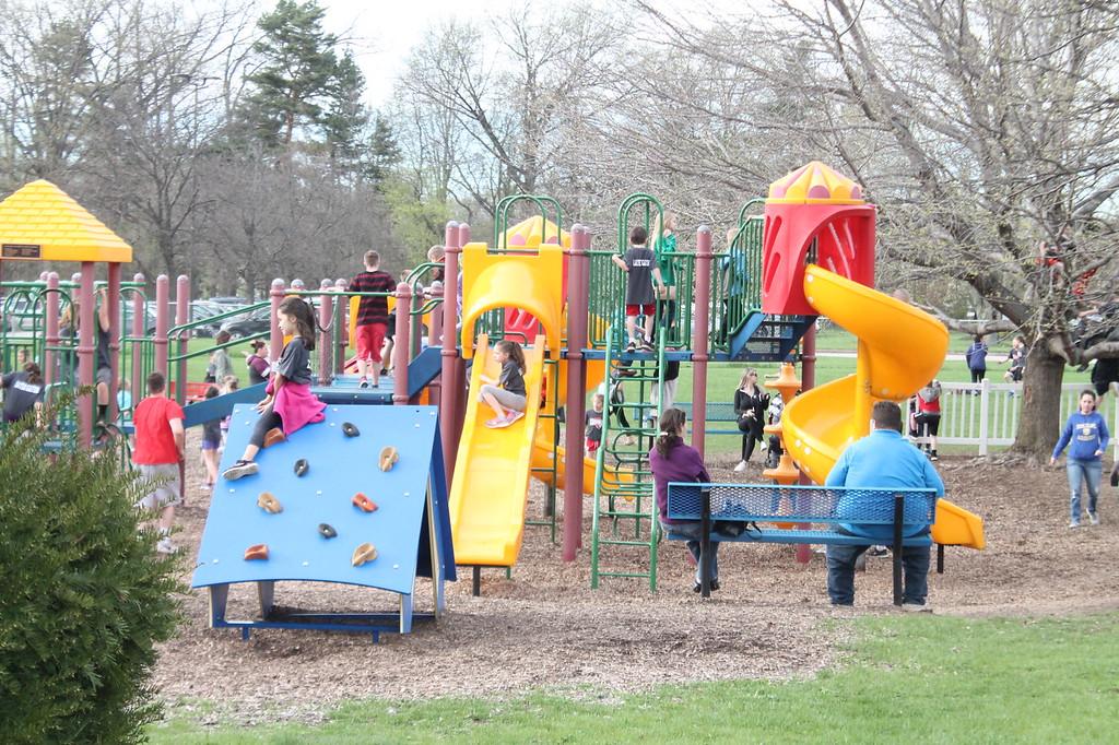. Kristi Garabrandt � The News-Herald <br> Hundreds of kids enjoyed the playground at Garfield Elementary School during goodbye celebration held May 4,  to mark the school\'s closing.