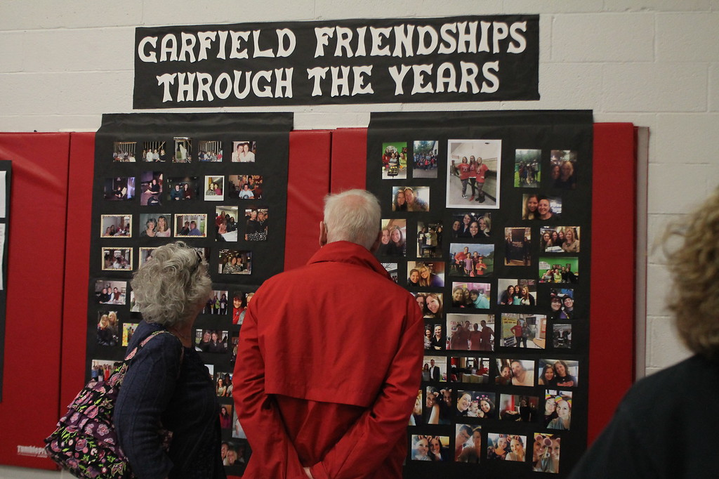 . Kristi Garabrandt � The News-Herald <br> Marilyn and Richard Kretschman look at one of the memory boards set up as part of the Strolling through the years display in the gymnasium at Garfield Elementary School to give the public a chance to view the schools history before it permanently closes. Marilyn is a former teacher at Garfield and the Kretschman\'s children attended the school.