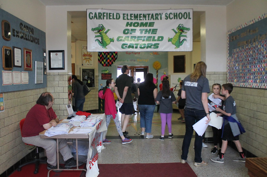 . Kristi Garabrandt � The News-Herald <br> Students at Garfield Elementary School act as tour guides to guest coming to see the school  before it permanently closes as the end of the school year.