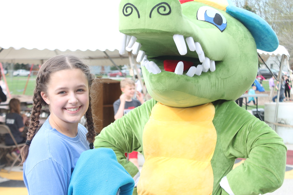 . Kristi Garabrandt � The News-Herald <br> Payton Sikora poses with the Garfield Gator mascot at the Lator Gator Bash at Garfield Elementary School on May 4. The bash  gave the Mentor community and opportunity to celebrate the school which will be permanently closing at the end of the school year.