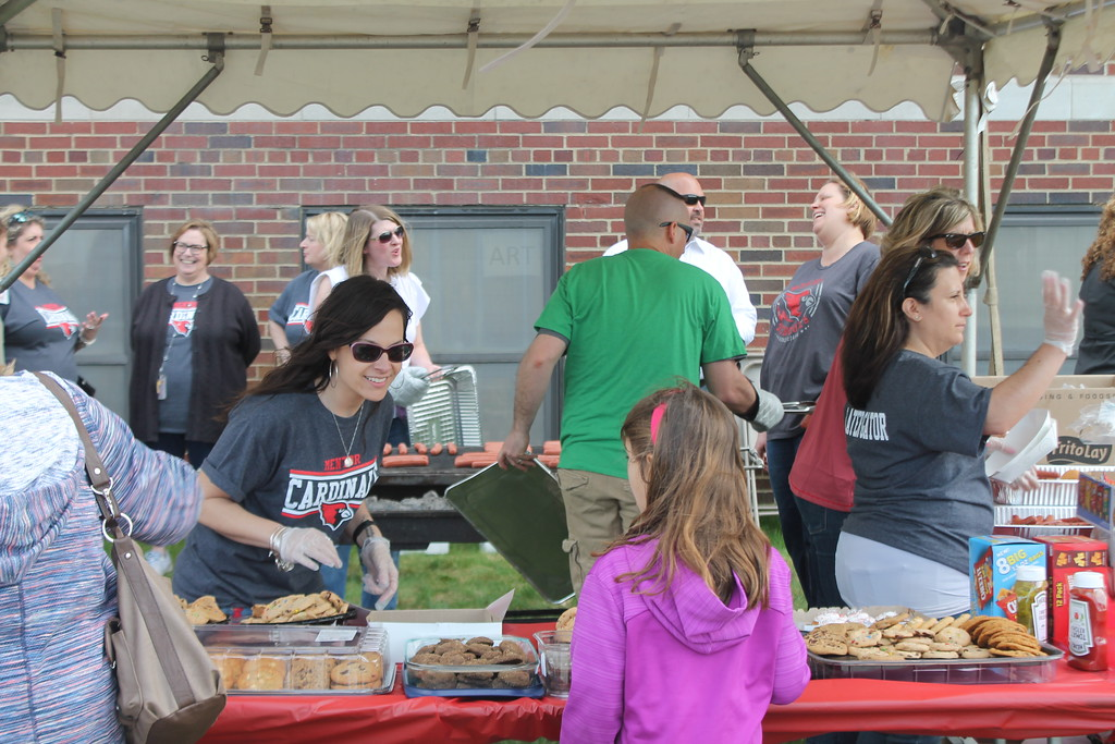 . Kristi Garabrandt � The News-Herald <br> Complimentary hot dogs, chips and desserts are served to community members who attended the Later Gator Bash on May 4.
