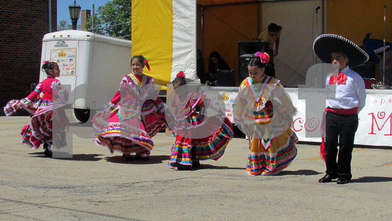 Rayitos del Sol, a Mexican folk dance troupe with Conexion Comunidad, a DeKalb-based nonprofit organization, perform Sunday during the 20th Cinco de Mayo Festival in Sycamore.