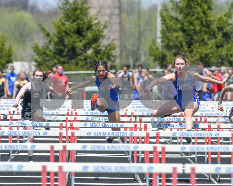 Genoa-Kingston Alison Kramer, right, along with teammate Edith Mercado, center, Rachael Andrews of Indian Creek compete in the 100 meter hurdles on May 5th at the Genoa-Kingston invite.