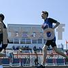 Tyler Leahy, right  of Genoa-Kingston runs the 1600 meter run May 5th at the Genoa-Kingston invite.