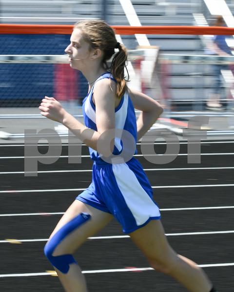 Izabella Cleaveland of Hinkley Big Rock runs the 1600 meter run on May 5th at the Genoa-Kingston invite.