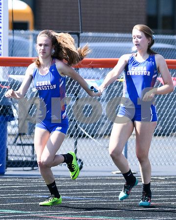 Genoa-Kingston runner Kaedyn Neblock, left, receives the hand off from teammate Alison Kramer during the first exchange of the 4x400 relay on May 5th