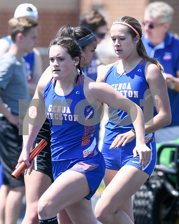 Hannah Chriss recieves the baton from teammate Gabby Janes during the 4x800 meter relay at the Genoa-Kingston invite on May 5th.