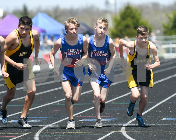 Genoa-Kingston teammates Gabe Campbell and Jacob Bray step off after the start of the 3200 meter run May 5th at the Genoa-Kingston invite.