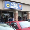 Patrons stand outside Comic Heaven on Free Comic Book Day. (Tawana Roberts/The News-Herald)