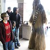 Chewbacca talks with other patrons of Comic Heaven on Free Comic Book Day. (Tawana Roberts/The News-Herald)