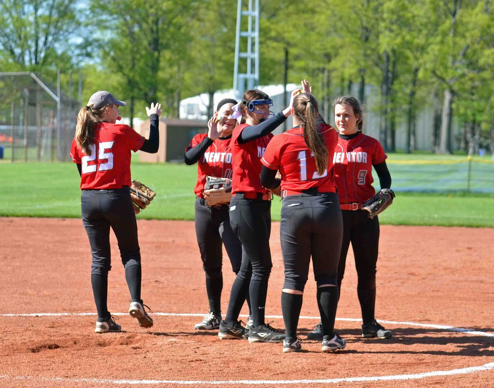 . Paul DiCicco - The News-Herald The Mentor infield conducts their pre-inning ritual.