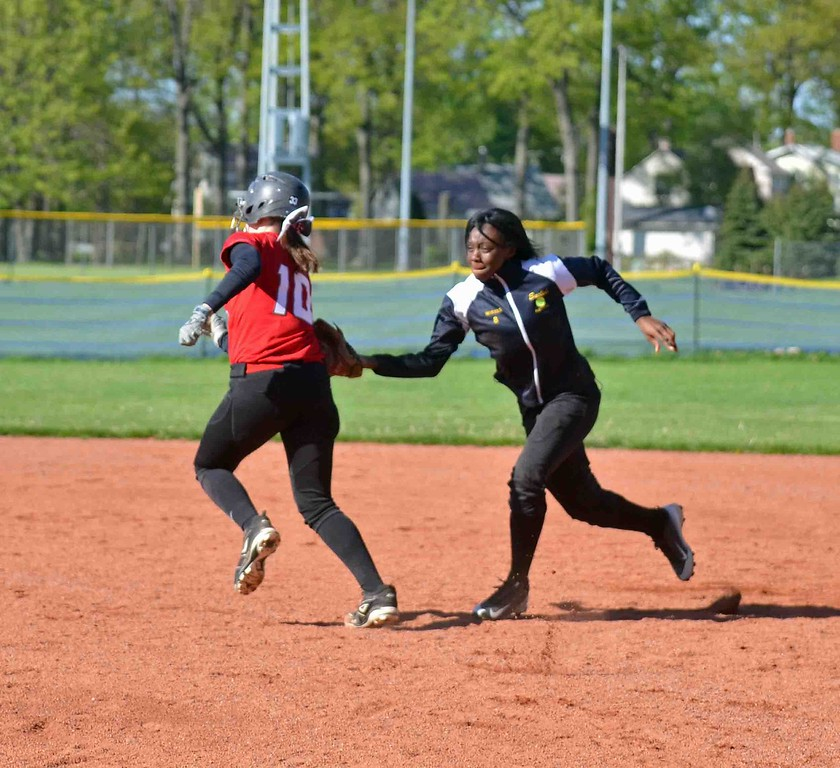 . Paul DiCicco - The News-Herald Euclid second baseman, Katelyn Wheeler, tags out a Mentor runner going to second.