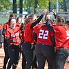 Paul DiCicco - The News-Herald<br /> Mentor's clean-up hitter, Raegan Thompson, is congratulated at home plate by her team after a homer to right-center field against Euclid on May 8.