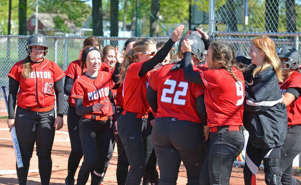 . Paul DiCicco - The News-Herald Mentor\'s clean-up hitter, Raegan Thompson, is congratulated at home plate by her team after a homer to right-center field against Euclid on May 8.